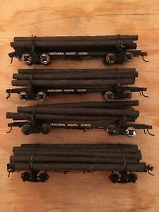 HO Rivarossi Lot of 4 Northern Pacific Skeleton Spine Log Cars With Loads NP