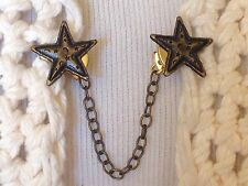 The mattie metal cut out antiqued gold star sweater clip