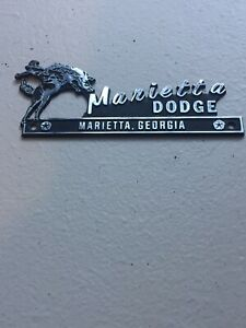Vintage Metal Dealership Emblem or Badge Featuring a Bucking Bronco   MOPAR