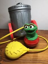 Fisher Price Sesame Street Oscar Grouch Trash Can Squeeze Toy 1977