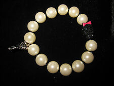 BETSEY JOHNSON ICONIC PEARL STRETCH BRACELET WITH SKULL WITH PINK BOW