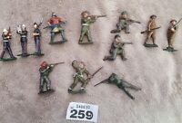 Vintage Lead Soldiers Hand Painted Group Of 12, 1 with movable arm Collectable