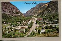 Postcard CO Ouray Aerial View Street View Houses Mountains 2406N