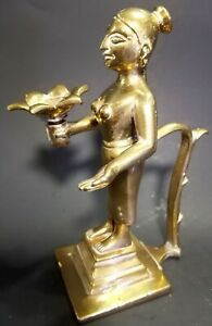 Vintage India cast  Brass Bronze India  woman  holding a oil lamp art Figurine