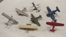 7 TOY AIRPLANES - 3 CORGI AND 4 Made in China with Pull back a release. 3 STANDS