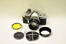 Minolta SR-1 35mm camera with a 55mm f1.8 & accessories shown. Beautiful