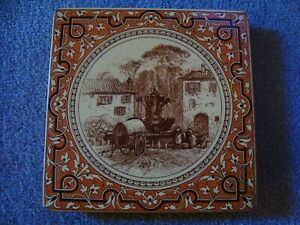 Antique Minton ceramic trivet depicting woman washing at a fountain  21/156A