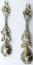 Antique diamond drop earrings. 1.25 inches long. Largest stone 5mm x 2.9mm.