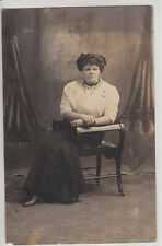 YOUNG WOMAN IN THE CHAIR . STUDIO PHOTO. VINTAGE REAL PHOTO POSTCARD
