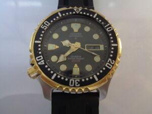 Citizen Diver Mens Watch Day & Date Auto Black Dial Silicone Lefty Bracelet