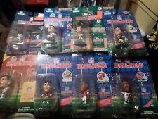 8 Big Head Headliners Figurines1 each basketball & baseball and 6 football