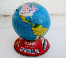 1950'S BANK OF WORLD STILL PIGGY BANK WITH COMPASS TIN LITHO JAPAN