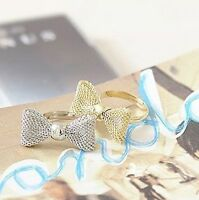 Cute adjustable gold / silver coloured mesh bow ring