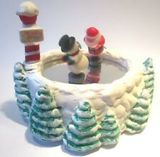 Music box. With moving Santa Claus with polar bear