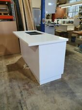 Island cupboard with gloss white doors and a ceasar stone top.