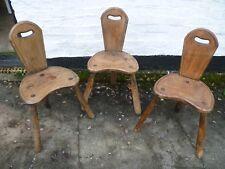 SET OF THREE ANTIQUE FRENCH, RUSTIC OAK, THREE LEGGED BAR CHAIRS. OAK BAR STOOLS