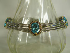 BRACELET:  EXQUISITE TWO-TONE GOLDEN FRAME SILVER RIBBONS AQUAMARINE OVAL CUT
