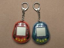 Digi Pets lot of 2 UNTESTED Red and Blue Electronic Virtual Pet Game Kids Only