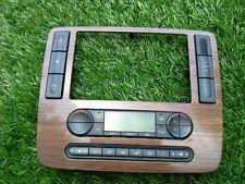 2004-2007 FORD FREESTAR RADIO RADIO TRIM BEZEL W/HEAT CONTOL UNIT WOODGRAIN A2