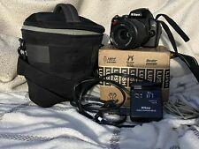 nikon d40, w/ AF-S nikkor 55-200mm lens, case, battery charger, download cable.