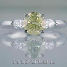 Solitaire with Accents Yellow Fine Diamond Rings