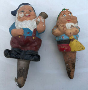 Two mini gnome plant pot watering funnels