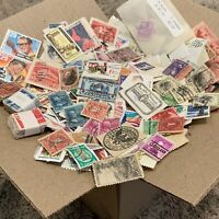 US STAMPS BOX LOT OFF PAPER. THOUSANDS OF STAMPS MOSTLY FROM THE UNITED STATES