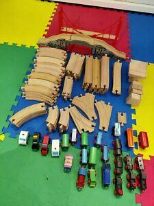 large bundle of wooden train track + bridges + trains