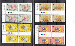 """HONG KONG, 1994, """"YEAR OF DOG"""" GUTTER NUMBER BLOCK OF 4 STAMP SETS MINT NH"""