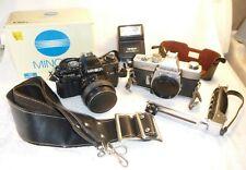 Two vintage Minolta 35mm cameras X-700 & SRT-101 - plus 50mm Lens and Flash