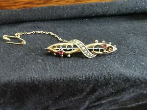 ANTIQUE 9CT GOLD RUBY AND SEED PEARL BROOCH WITH SAFETY CHAIN INITIALLED CMW