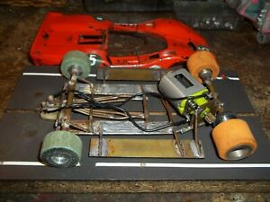 VINTAGE BRASS CHASSIS SLOTCAR 7 REWIND MOTOR ARM STRONG