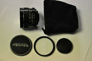 Asahi Pentax early 28mm f3.5 lens with M42 mount, 58mm UV filter, caps and case.