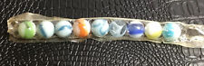VINTAGE UNOPENED PACKAGE OF GLASS MARBLES PRETTY COLORS