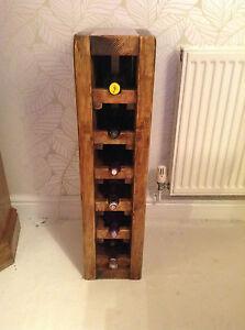 A handcrafted 6 bottle Stand De Vin (wine rack)