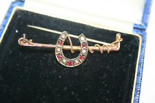 Horseshoe and whip Gold garnet and pearl Victorian brooch
