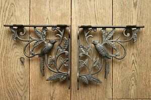 A pair of antique Victorian exotic bird brackets damaged read description