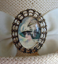 VICTORIAN LADY IN GLASS CABOCHON ON OLD BRASS FINISH HATPIN