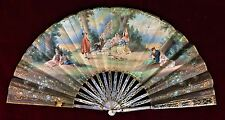 FAN. MOTHER OF PEARL, CARVED, AND GILDED, . PAINTED PAPER. FRANCE. CIRCA 1800