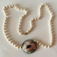 White knotted faux pearls necklace with round flat 2 sides pendant an... Lot 22A