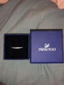 Swarovski simple ring size 52 with zirconias in a box perfect condition.