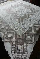 "Vintage hand worked filet lace tablecloth - 46"" x 42"". In cream."