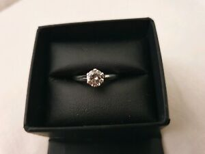 Solitaire .80 crt white gold diamond ring