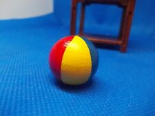 A COLOURED BEACH BALL FOR THE DOLLS HOUSE CHILDREN