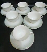SIX ROYAL DOULTON TC1021 BERKSHIRE PATTERN FOOTED TEA CUPS, SAUCERS & PLATES