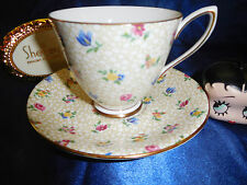 SHELLEY FLORAL CHINTZ   CARLISLE SHAPE  FOOTED CUP AND SAUCER   GOLD TRIM