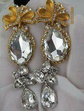 Vintage very beautiful Rhinestones gold tone clip earrings Swan Signed Swarovski