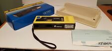 Vintage yellow Graflex camera 110 TeleAF built-in flash box and instructions
