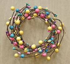 Spring colored pink yellow teal candle wreath