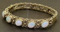 Antique heavy 14K gold 7.50CTW 9 X 7mm cabochon opal filigree bangle bracelet